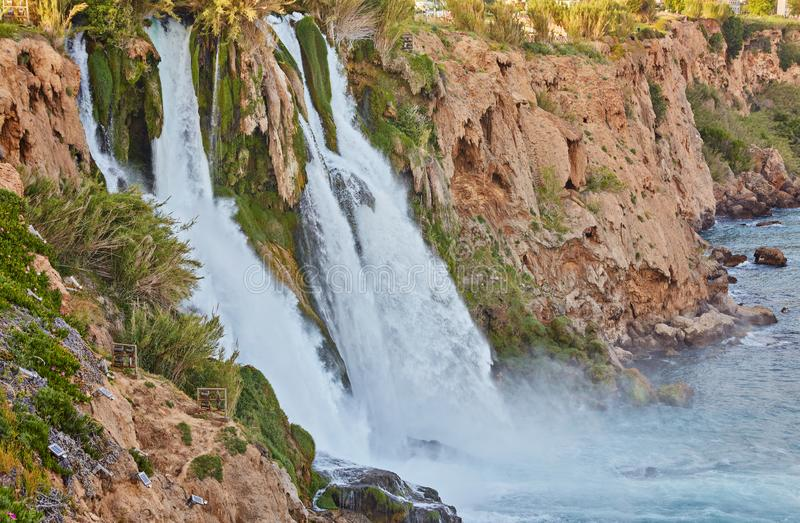 Lower Duden waterfalls on Mediterranean sea coast, Antalya, Turkey. In sunset light royalty free stock photography