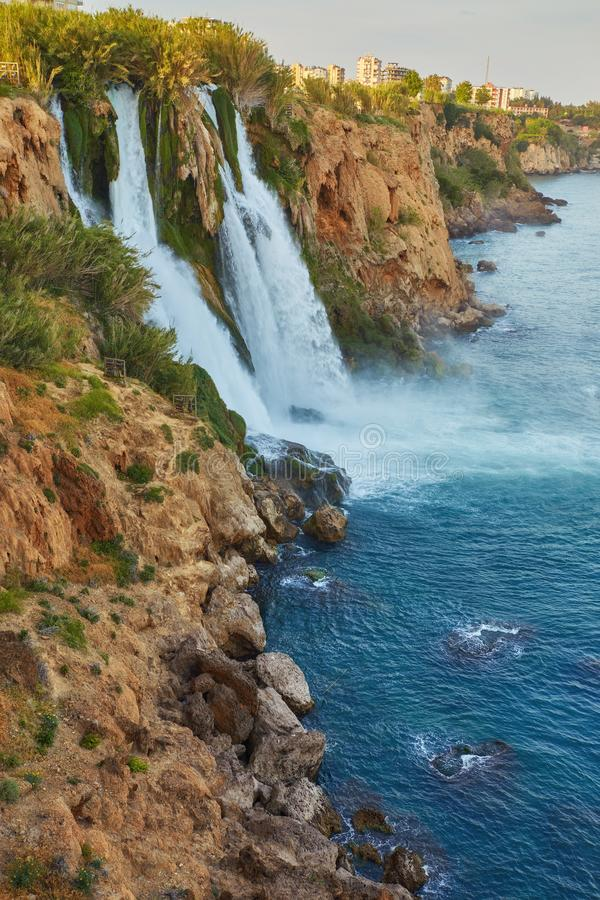 Lower Duden waterfalls on Mediterranean sea coast, Antalya, Turkey. In sunset light royalty free stock photos