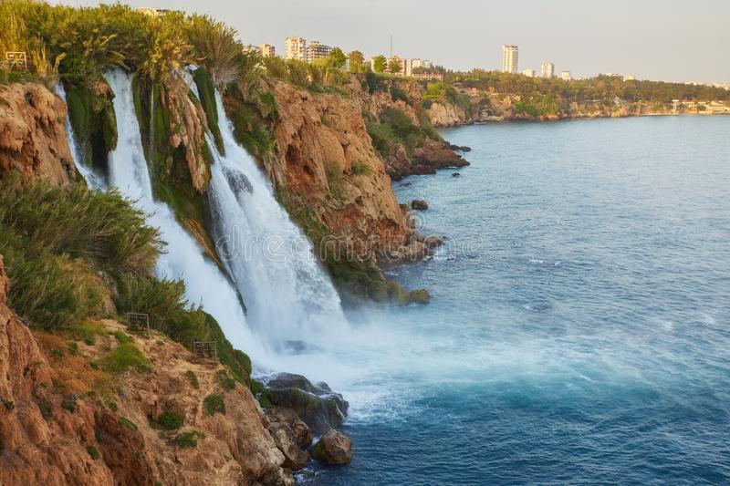 Lower Duden waterfalls on Mediterranean sea coast, Antalya, Turkey. In sunset light royalty free stock images