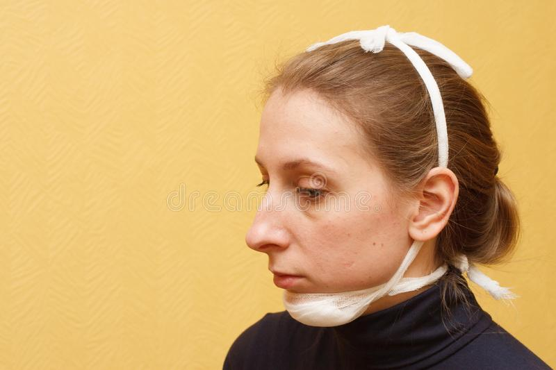 Lower jaw injury medical first aid fixing bandage royalty free stock photo