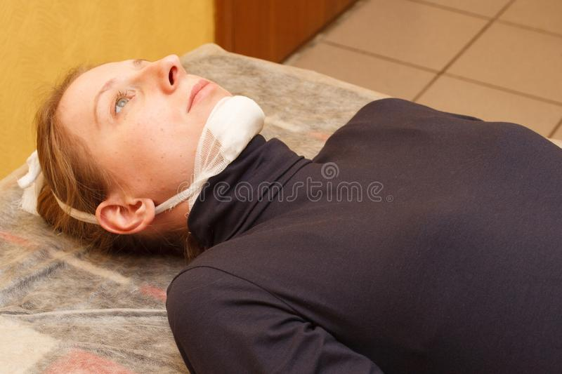 Lower jaw injury medical first aid fixing bandage stock photos