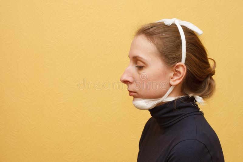 Lower jaw injury medical first aid fixing bandage stock image