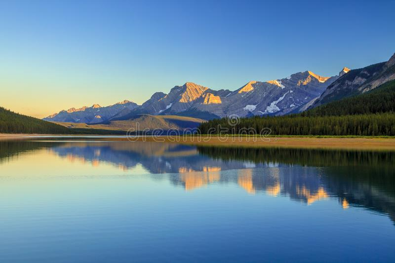 Lower Kananaskis Lake at sunset on a clear summer day stock photography