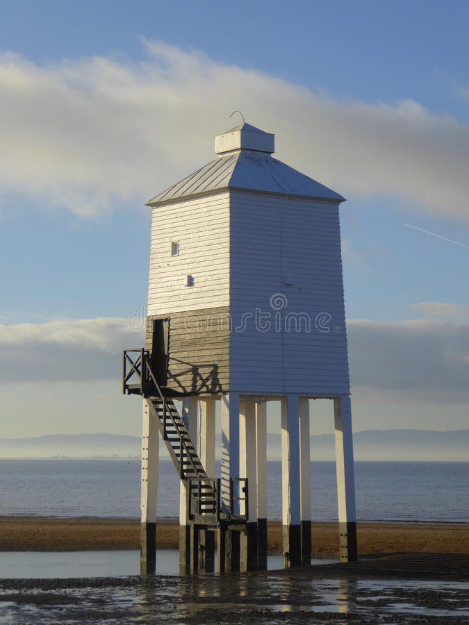 Wooden Lighthouse on beach royalty free stock photo