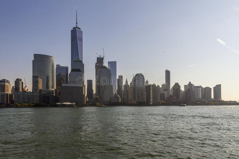 Lower Manhattan skyline from a boat royalty free stock image