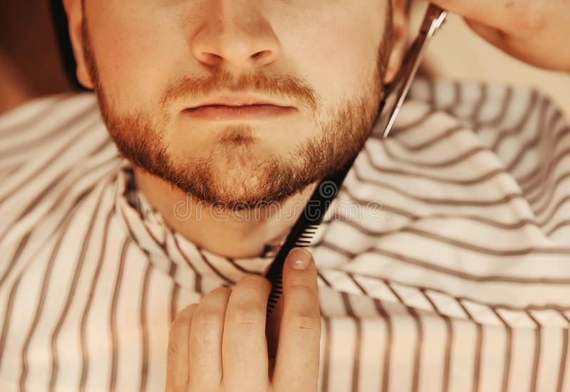 Lower part of face bearded man in men hair salon close up royalty free stock photo