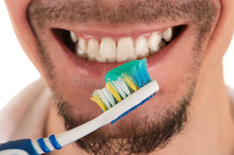 Lower part of face of man and toothbrush royalty free stock images