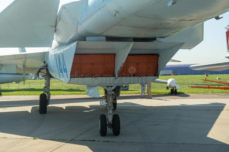 The lower part of the fuselage and landing gear. View of the plane from below royalty free stock photos