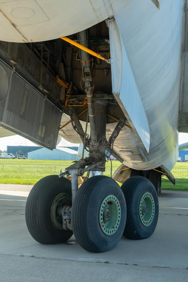 The lower part of the fuselage and landing gear. View of the plane from below stock photos