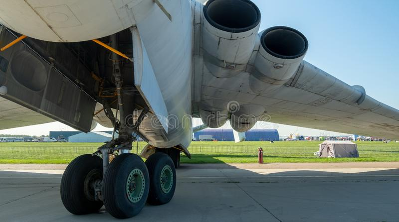 The lower part of the fuselage, wing and landing gear. View of the plane from below stock image