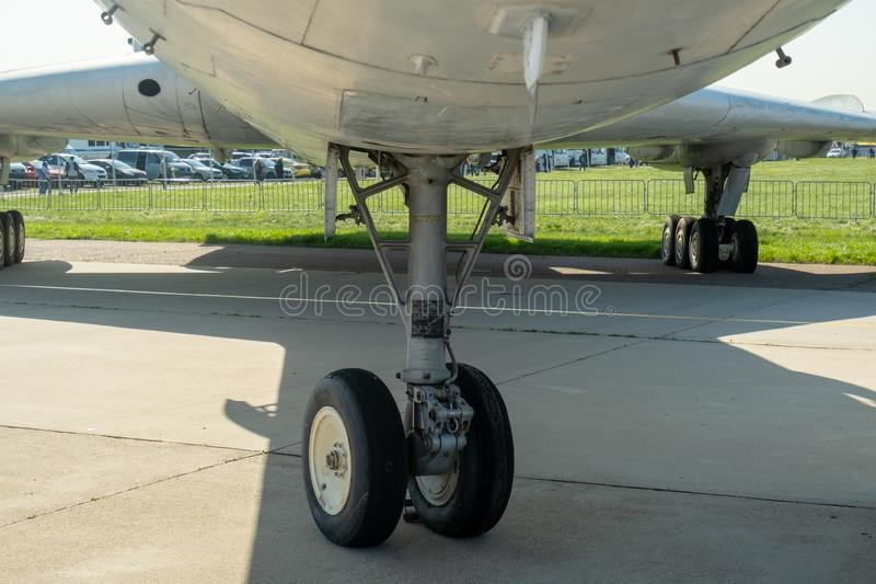 The lower part of the fuselage, wings and landing gear. View of the plane from below stock photo