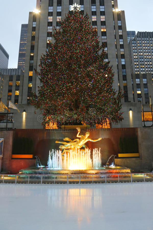 Lower Plaza of Rockefeller Center with ice-skating rink and Christmas tree in Midtown Manhattan. NEW YORK - DECEMBER 18: Lower Plaza of Rockefeller Center with royalty free stock photo