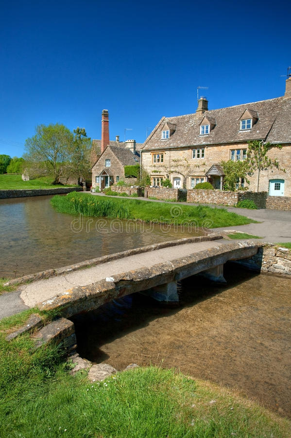 Lower Slaughter. The old footbridge in the Cotswold village of Lower Slaughter, Gloucestershire, England stock photo