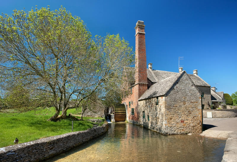 Lower Slaughter. The old water mill in the Cotswold village of Lower Slaughter, Gloucestershire, England royalty free stock photos