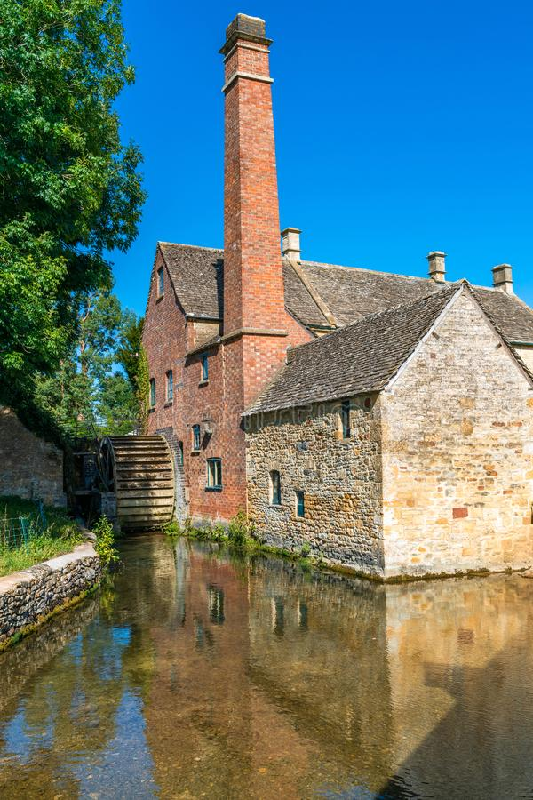 Lower Slaughter village in Cotswolds, UK. LOWER SLAUGHTER, UK - SEPTEMBER 21, 2019: Grade II-listed water mill in Cotswolds village of Lower Slaughter dates from royalty free stock images