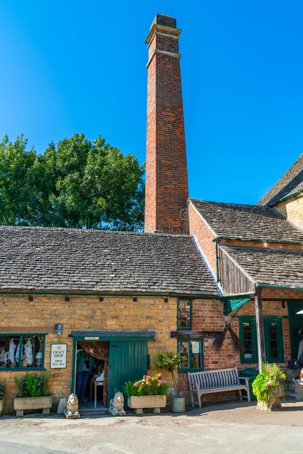 Lower Slaughter village in Cotswolds, UK. LOWER SLAUGHTER, UK - SEPTEMBER 21, 2019: Lower Slaughter is a village in the Cotswold district of Gloucestershire royalty free stock photo