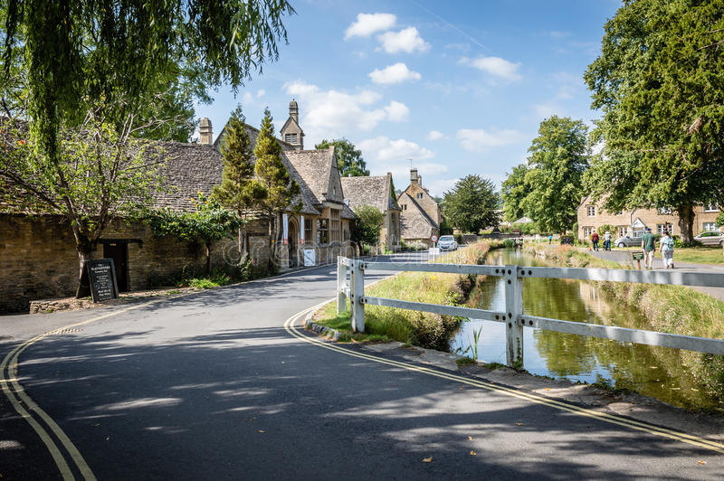 Lower Slaughter view. River in the village a blue sky day. Lower Slaughter is known for its limestone cottages in the traditional Cotswold style stock photography
