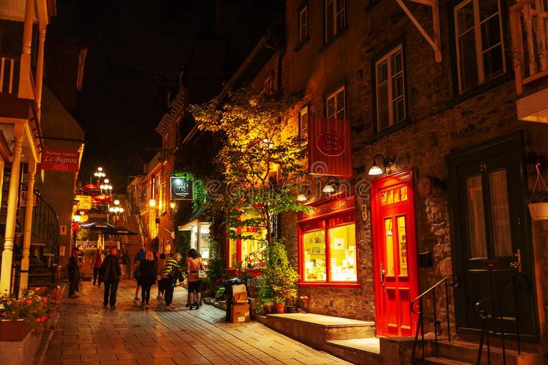 Lower Town of Place Royale at Old Quebec in Canada. QUEBEC CITY, CANADA - AUG 21, 2012: Tourists meander the Lower Town street of Place Royale at night. The royalty free stock photos