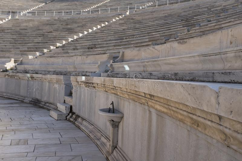 Marble seats in the ancient Panathenaic stadium in Athens. Lowest section of marble seats in the Panathenaic stadium first built in 330 BC and then rebuilt in stock images