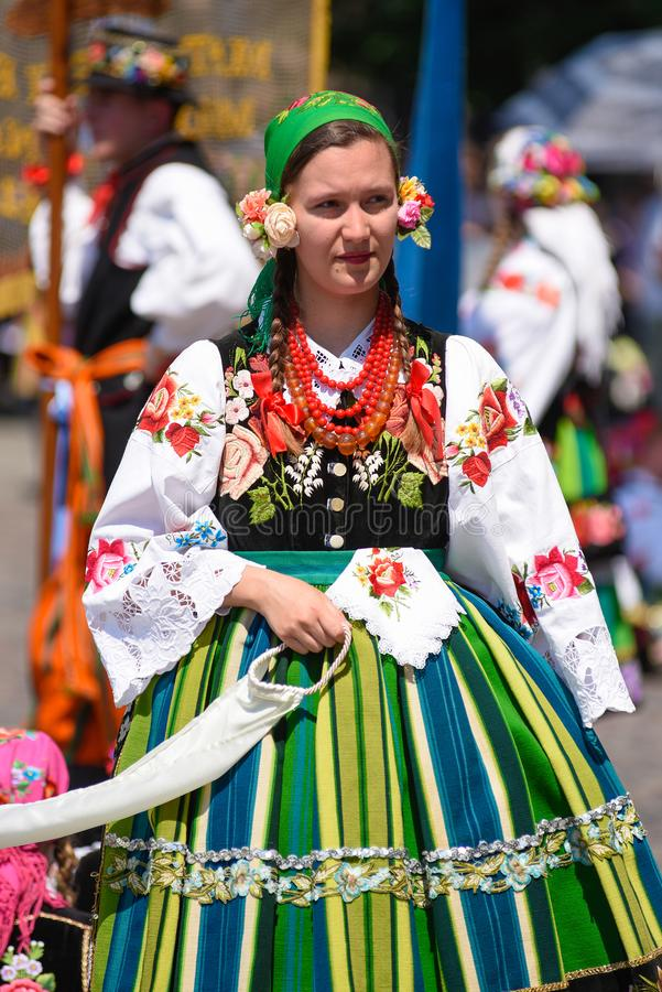 Lowicz / Poland - May 31.2018: Corpus Christi church holiday procession. Local women dressed in folk, regional costumes. stock images