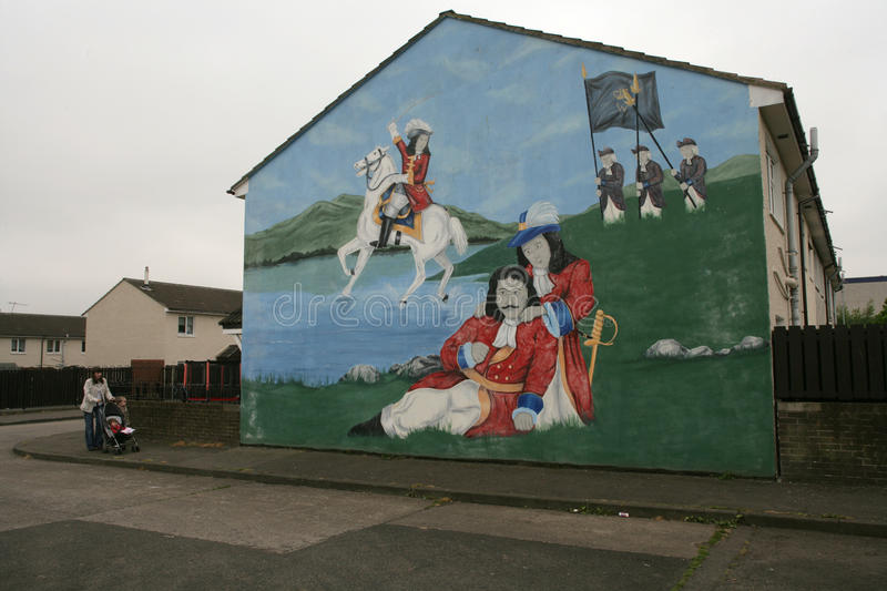 Loyalist murals on Hopewell Crescent, Lower Shankill, Belfast of William of Orange. Loyalist mural of King William of Orange defeating King James II at the Boyne royalty free stock images