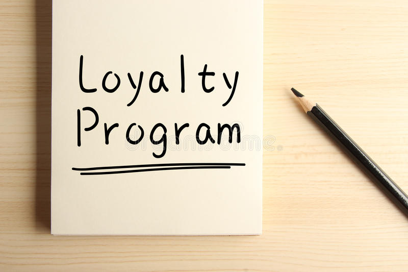Loyalty Program. Text Loyalty Program with underline on the notebook with a pencil aside royalty free stock photography