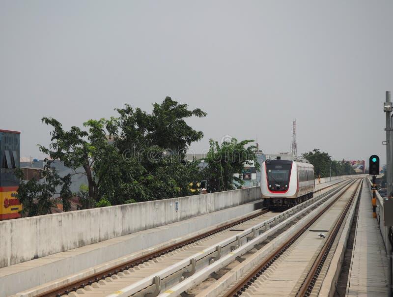 LRT Jakarta. Jakarta, Indonesia - June 17, 2019: LRT Jakarta train running at Kelapa Gading Boulevard Selatan Station stock image