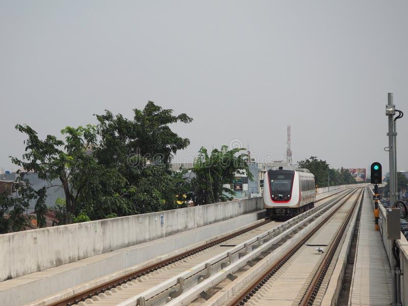 LRT Jakarta. Jakarta, Indonesia - June 17, 2019: LRT Jakarta train running at Kelapa Gading Boulevard Selatan Station stock photo