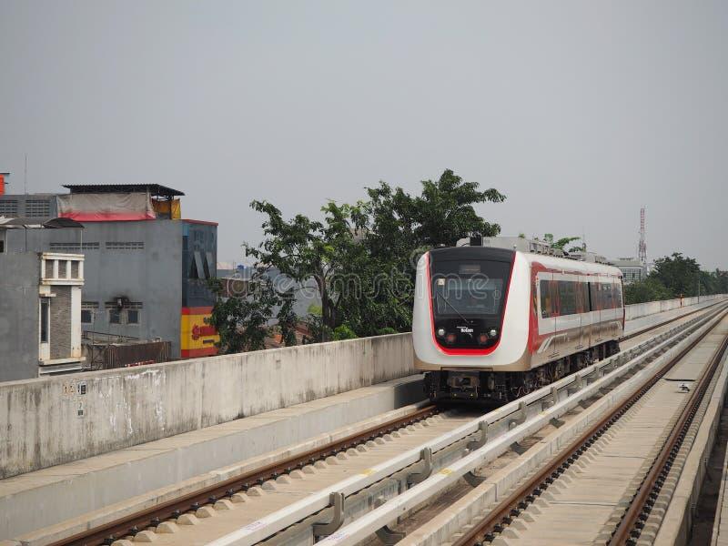 LRT Jakarta. Jakarta, Indonesia - June 17, 2019: LRT Jakarta train running at Kelapa Gading Boulevard Selatan Station royalty free stock photography