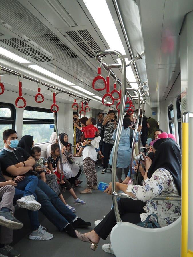 LRT Jakarta. Jakarta, Indonesia - June 17, 2019: Passengers on the train of LRT Jakarta at Kelapa Gading Boulevard Selatan LRT Station stock image