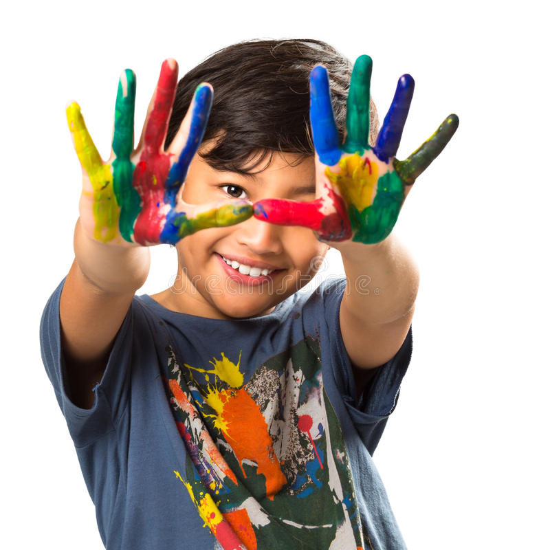 Lttle asian boy with hands painted in colorful paints royalty free stock photo