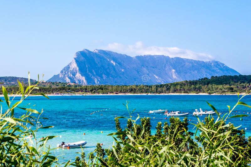 Lu impustu beach in Sardinia, with Tavolara island in the background, Italy stock photography