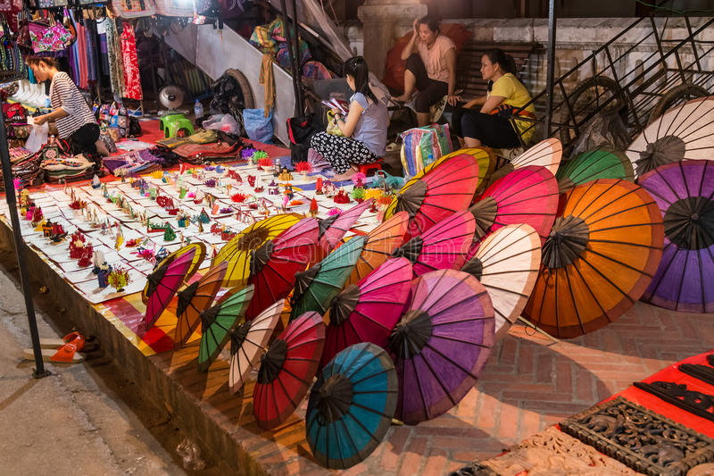 Luang Prabang, Laos - circa August 2015: Souvenirs are sold at night market in Luang Prabang, Laos stock images