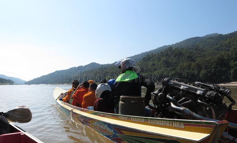 Group of Buddhist monks travel on speed boat on Mekong River stock photo