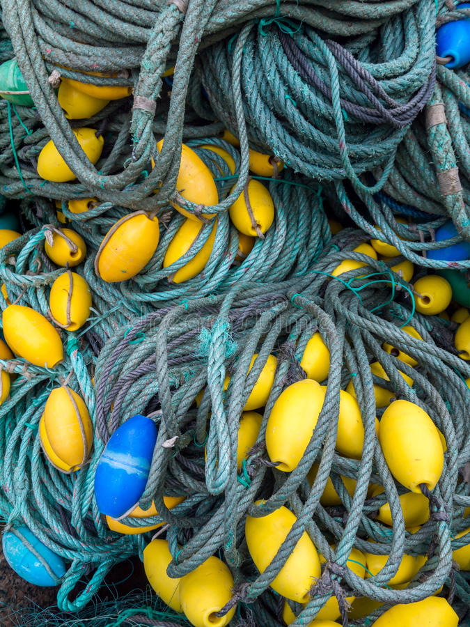 LUARCA, SPAIN - DECEMBER 4, 2016: Blue and yellow fishing gear a. T the fish market pier in Luarca, Spain royalty free stock photo