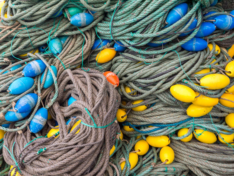 LUARCA, SPAIN - DECEMBER 4, 2016: Colorful fishing gear at the f. Ish market pier in Luarca, Spain royalty free stock images