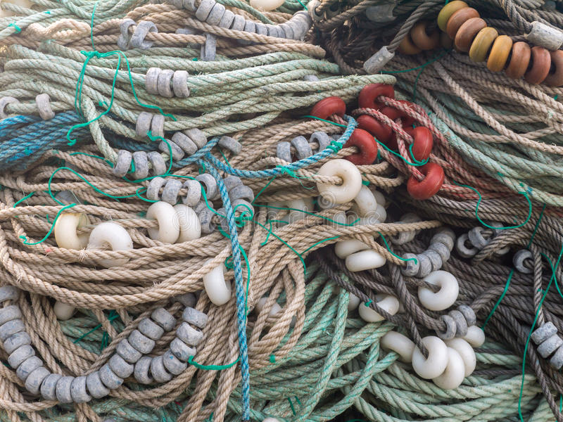 LUARCA, SPAIN - DECEMBER 4, 2016: Colorful ropes,floats and sink. Ers at the fish market pier in Luarca, Spain royalty free stock photography