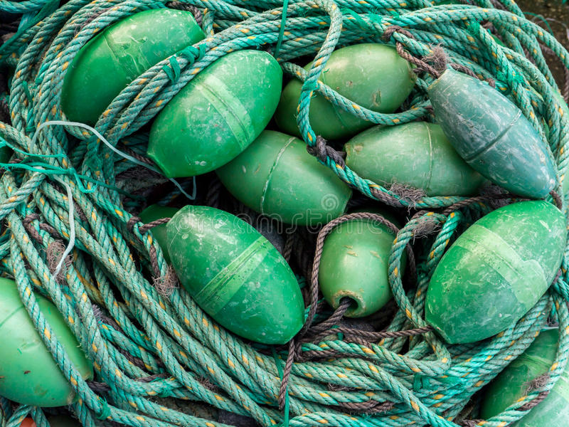 LUARCA, SPAIN - DECEMBER 4, 2016: Green fishing gear at the fish. Market pier in Luarca, Spain stock images