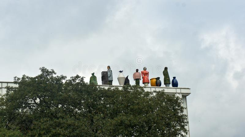 Lubeck, Germany - 07/26/2015 - Figures on the roof of Music and Congress Centre stock photos