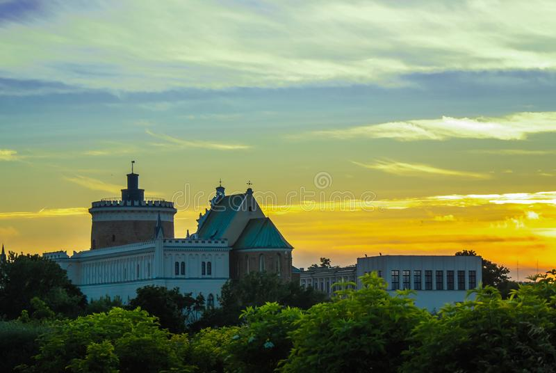 Lublin castle at sunset next to colorful gradient clouds royalty free stock photography