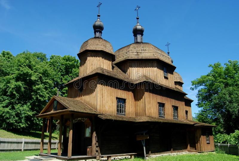 Lublin, Poland: 1759 St. Nicolas Church. Historic 1759 St. Nicolas Greek Orthodox church and its adjacent free-standing wooden belfry at the Regional stock photos