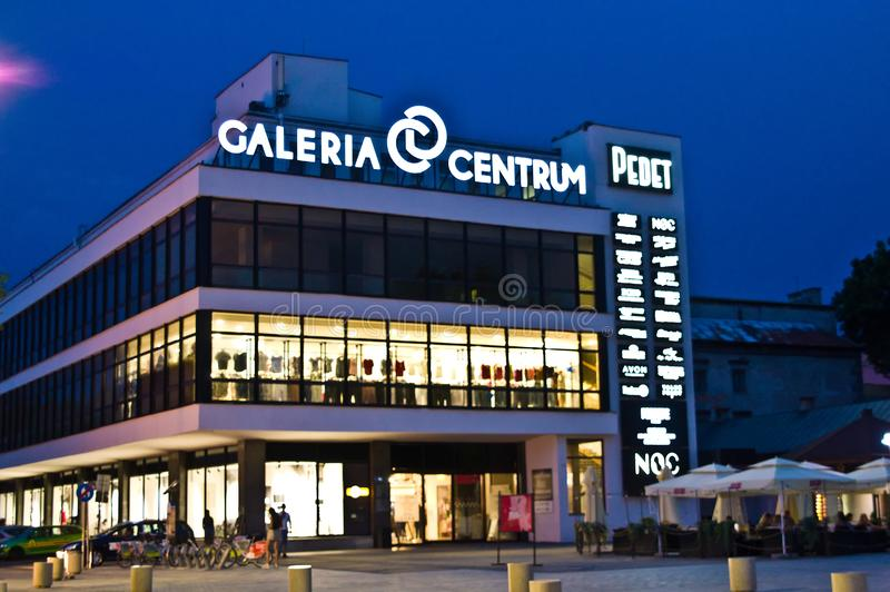 Lublin, Poland, Galeria Centrum mall at night. Lublin, Poland, July 2019: Galeria Centrum Centre Mall at night, facade with neon signs royalty free stock image
