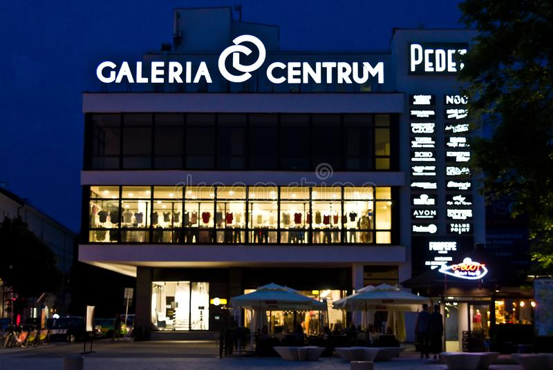 Lublin, Poland, Galeria Centrum mall at night. Lublin, Poland, July 2019: Galeria Centrum Centre Mall at night, facade with neon signs stock photo