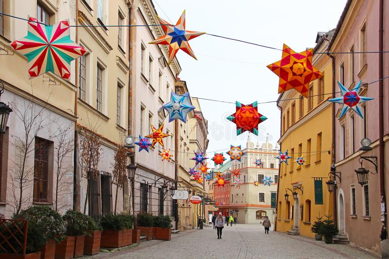 Lublin old town, Poland. LUBLIN, POLAND - JANUARY 16, 2018: Bramowa street in Lublin old town with Christmas decorations royalty free stock photos
