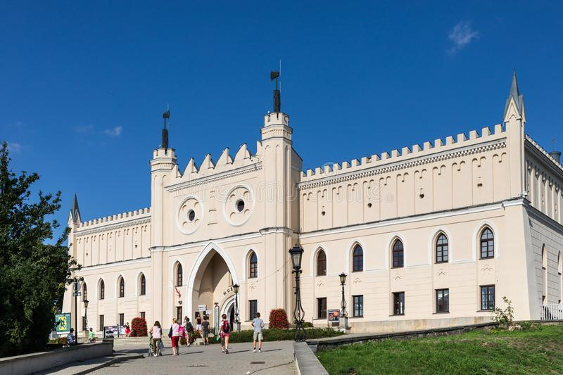 Royal Castle of Lublin, Poland. Lublin, Poland - Jul 27, 2018: Royal Castle of Lublin, bridge with tourists. The Lublin Castle is a medieval castle in Lublin royalty free stock images