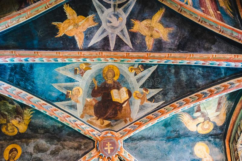 Ceiling frescoes - with Christ, angels and pigeon stock photography