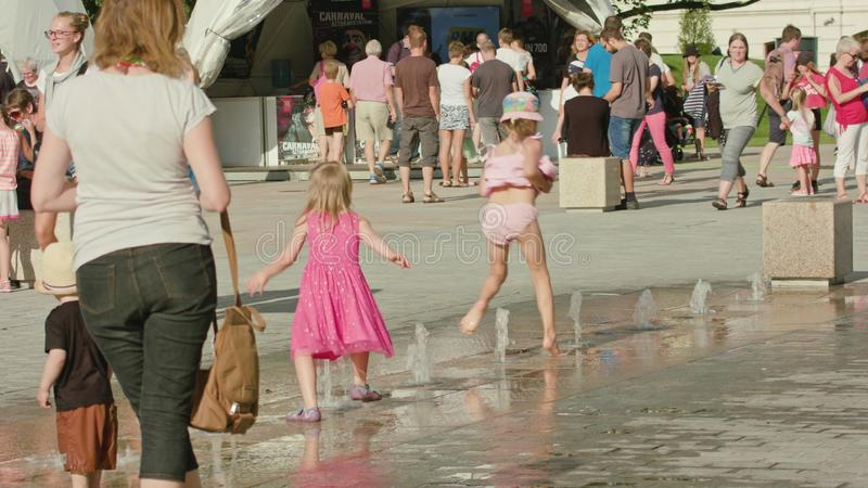 Little Girls Playing in Street Fountain, Lublin royalty free stock image