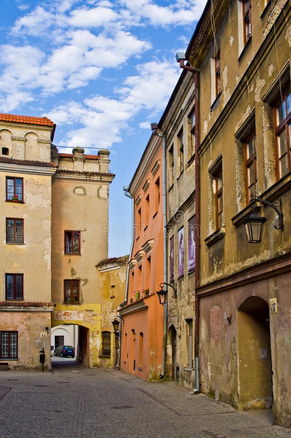 Lublin Poland, Old Town street with colorful house facades. Lublin, Poland, July 2019: the Old Town street with colorful houses facades on a sunny evening royalty free stock photography