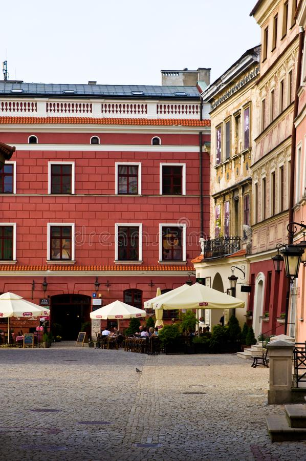 Lublin Poland, Old Town street with colorful house facades. Lublin, Poland, July 2019: the Old Town street with colorful houses facades on a sunny evening royalty free stock image