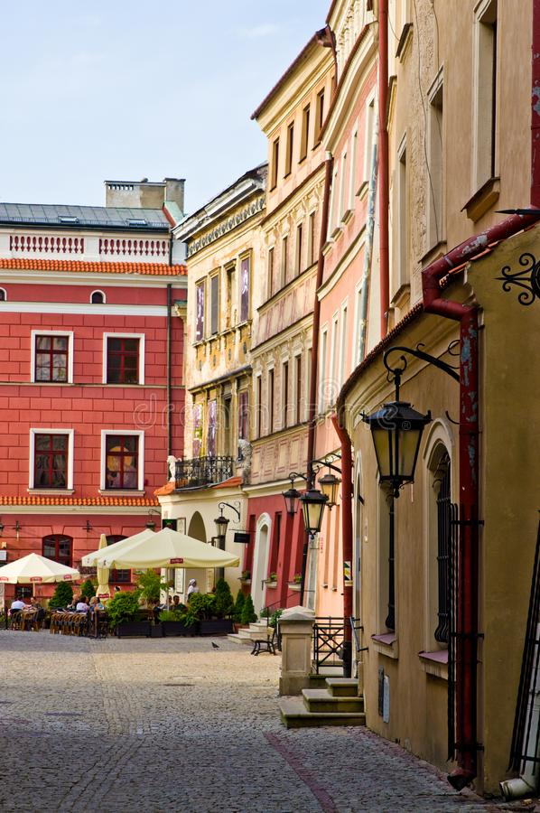 Lublin Poland, Old Town street with colorful house facades. Lublin, Poland, July 2019: the Old Town street with colorful houses facades on a sunny evening royalty free stock images